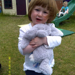 One female child holding a teddy.